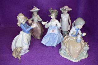 Five Nao figurines, Girl carrying Dove, Girl with Parasol, Girl carrying Cake, Girl carrying