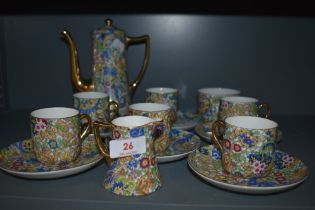 A part coffee service having gilt and paisley transfer print design