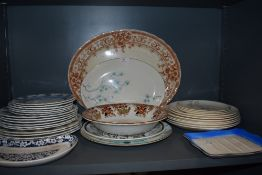 An assortment of vintage ceramics including Meakin plates, platters and bowls.