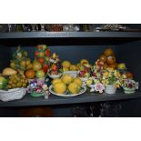 A selection of ceramic model fruit baskets and similar floral examples mostly from Portugal or