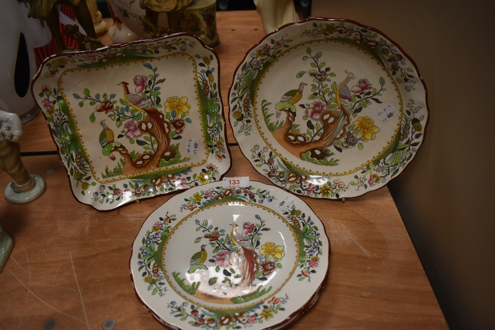 Four Spode plates having oriental florals and Peacock and hen pattern.