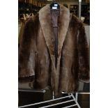 A ladies vintage fur coat.