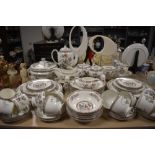 A large collection of Wedgwood 'Kutani Crane' including coffee cans,cups and saucers, bowls,plates