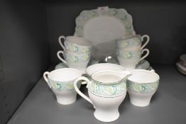 A selection of tea cups and saucers by Bell china in an art deco design