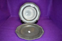 A pair of matching pewter plates having worn mark and angel stamp to reverse