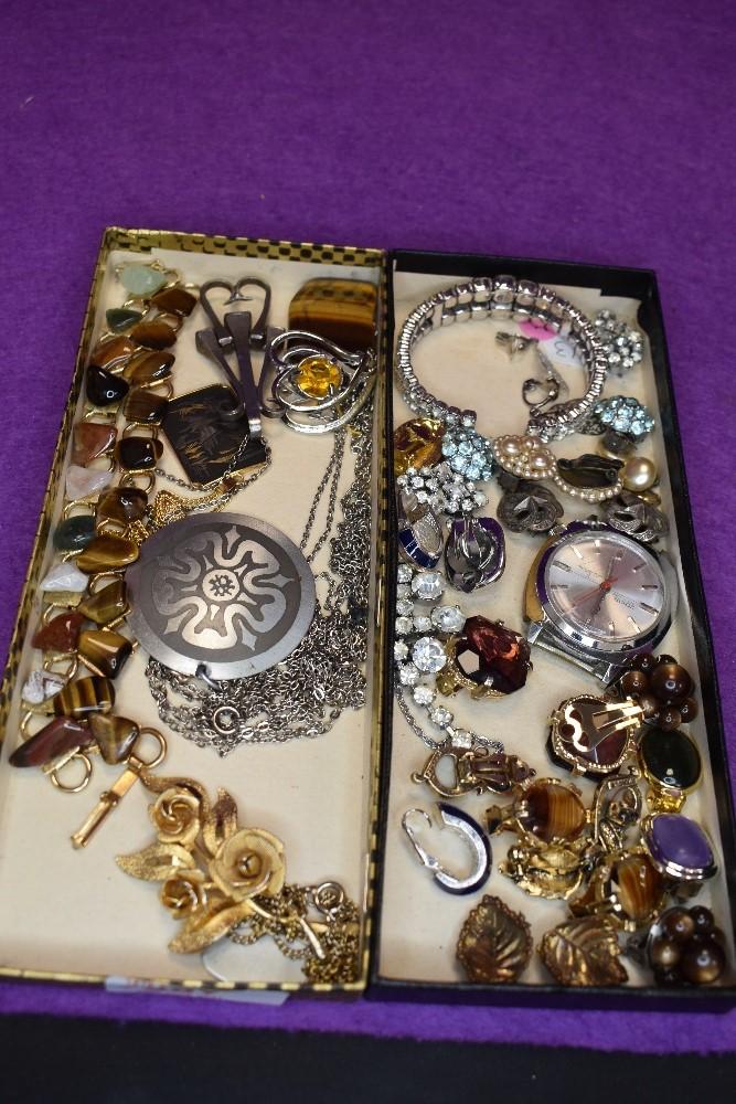 A selection of costume jewellery including polished stone bracelets, clip earrings, Joyas watch face