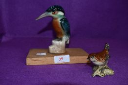 A ceramic figure of a kingfisher hand decorated with a similar Beswick wren