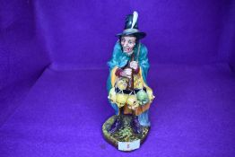 A Royal Doulton Figurine, The Mask Seller HN2103