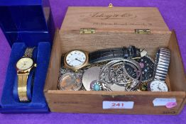 A vintage wooden cigar box containing a selection of necklaces and wrist watches including a cased