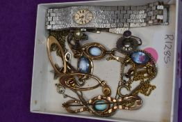 A small selection of costume jewllery including screw back earrings, gold plated loop style stud
