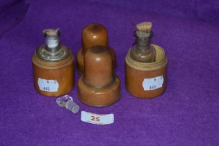 A pair of turned box wood case medical bottles