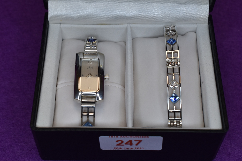 A cased watch set by Henley collection in the Rennie Mackintosh style