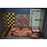 A mixed lot of vintage board games amongst which are Bionic Crisis, dominos, monopoly and more.