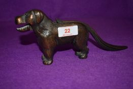 A vintage nutcracker in the form of a dog stamped made in England with reg mark
