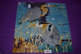 A large ceramic tile of two heron birds signed Pierce
