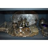 A large lot of plated ware including toast rack,serving dish with blue glass liner, tureen and