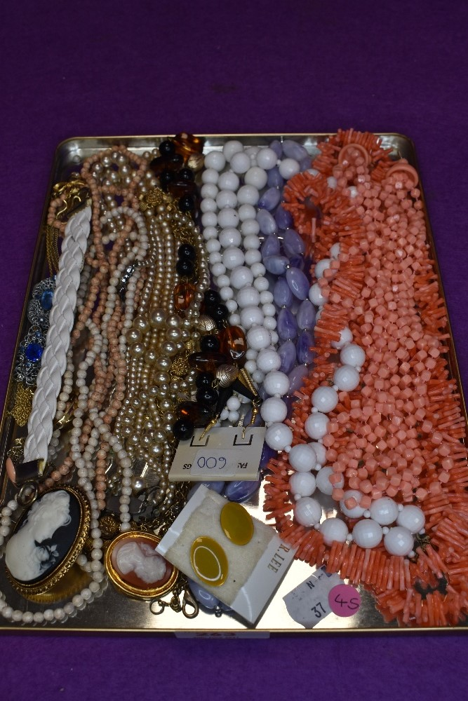 A selection of costume jewellery inclusing strings of beads, earrings etc