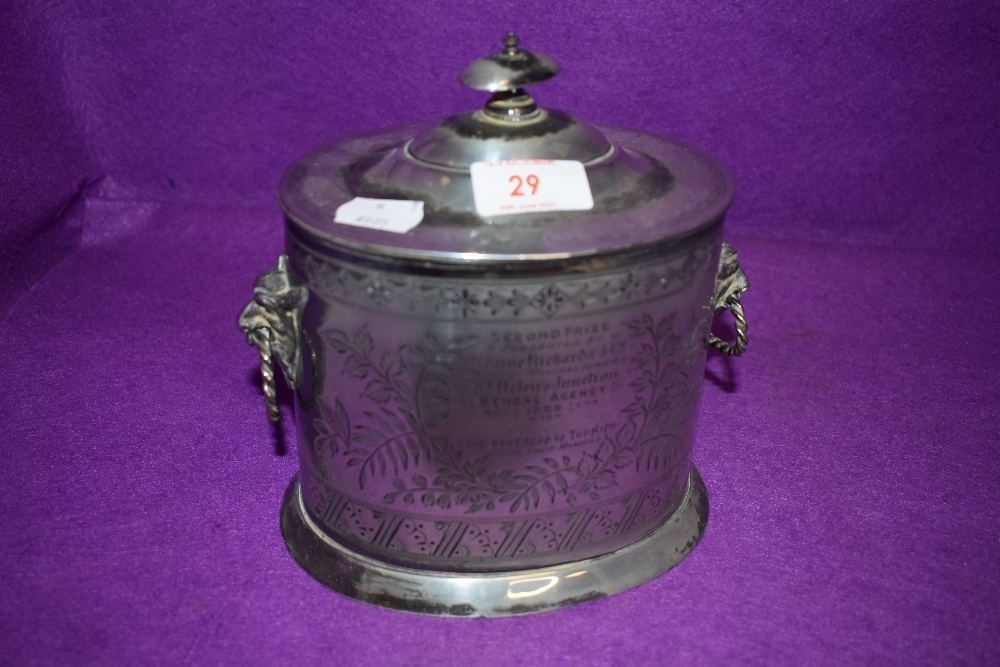 A silver plated biscuit barrel having mythical beast styled handles and retailed by Walker Hall