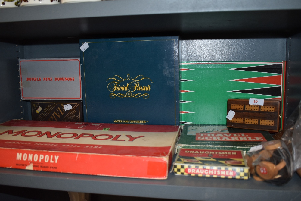 A selection of childrens board and card games including Monopoly and Trivial Presuit