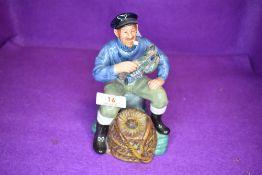 A Royal Doulton Figurine, The Lobster Man HN2317