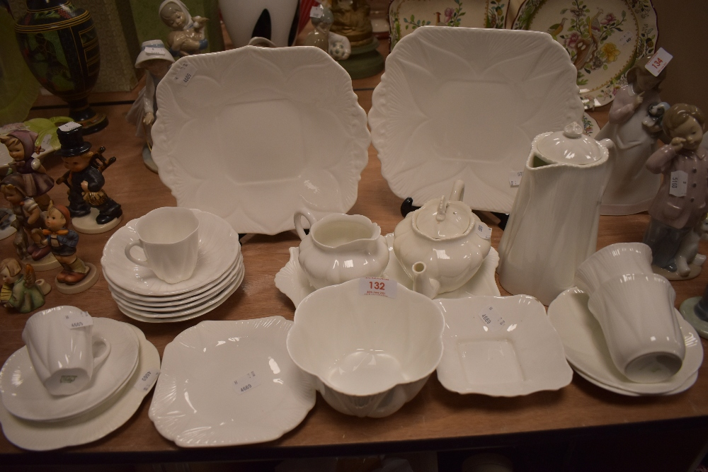 A collection of Shelley dainty white including tea pot,coffee pot,sugar basin and more.