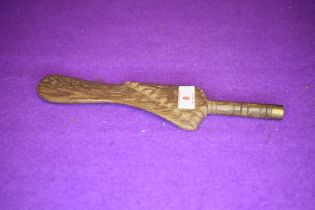 An antique knitting stick or distaff in hardwood having carved decoration