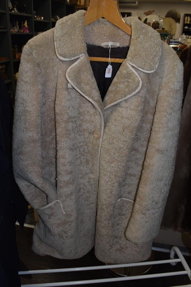 A vintage sheepskin coat,around a medium size.