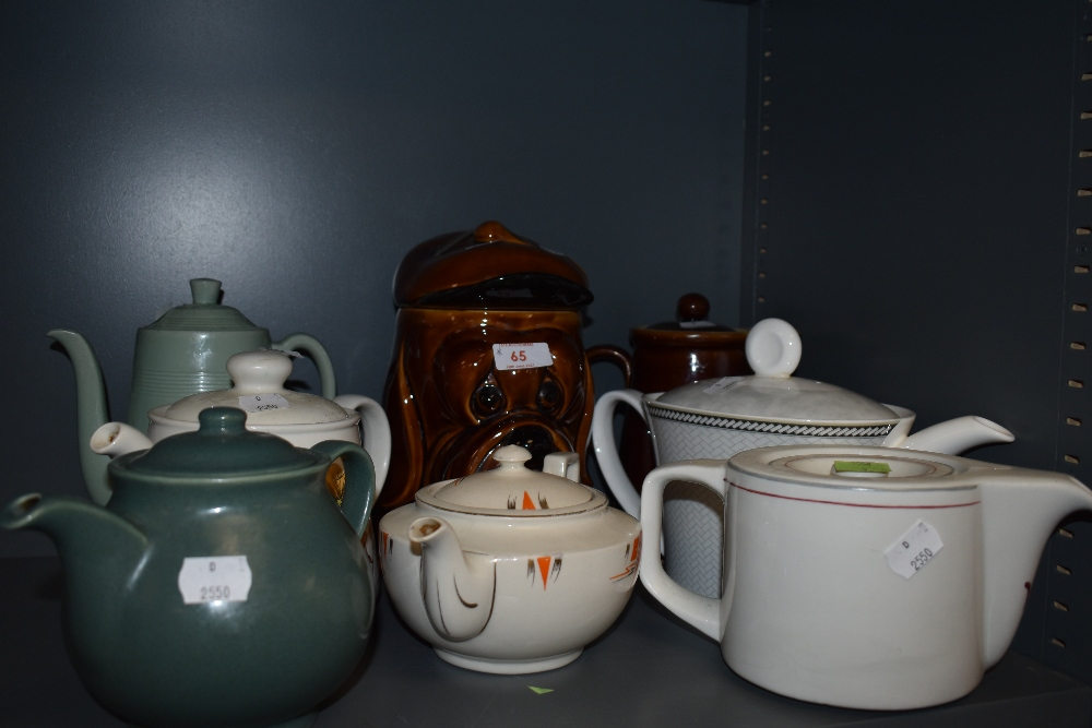 A selection of vintage and retro tea and coffee pots including Woods ware Beryl and a novelty dog