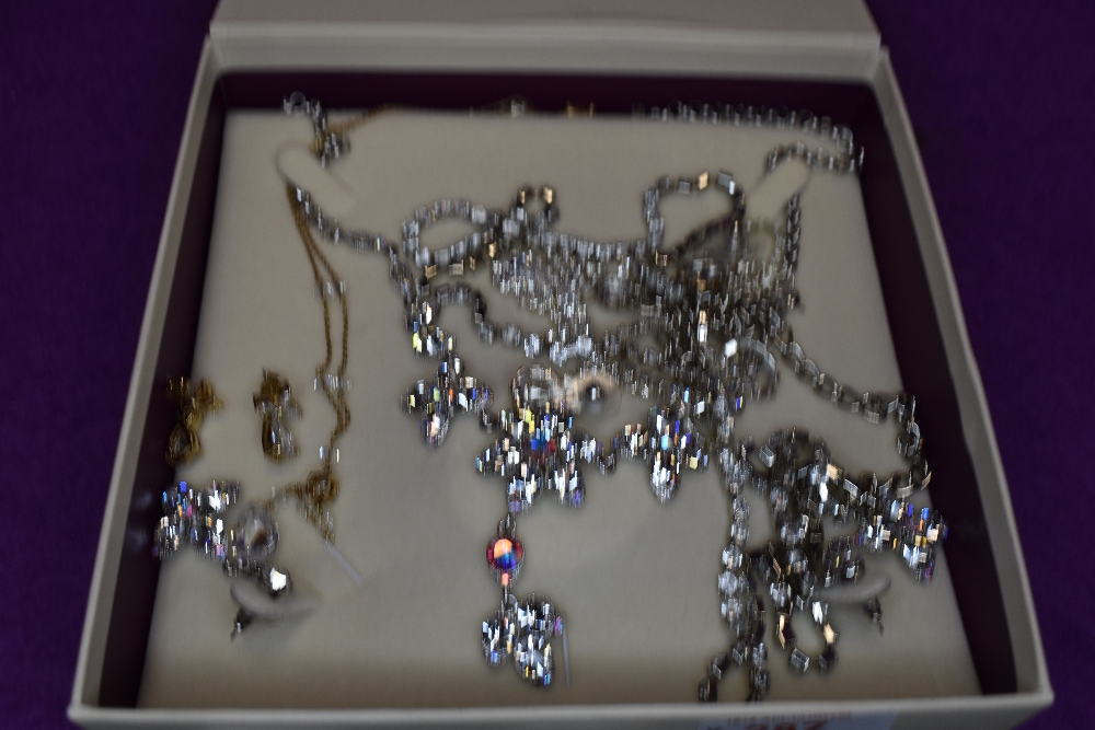 A selection of diamante jewellery including necklaces and earrings of various forms