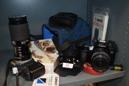 A selection of photography equipment and camera including Canon T70 and EOS 1000F