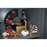 A selection of curios and dressing items including fans coin purse and manicure set