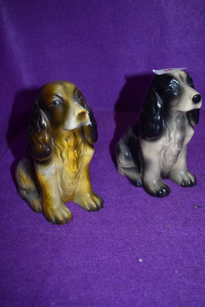 Two cocker spaniel figurines.