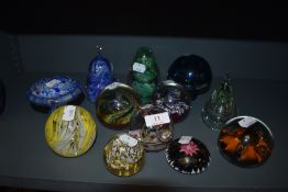 A selection of art glass paper weights and glass mushroom including Caithness and Selkirk