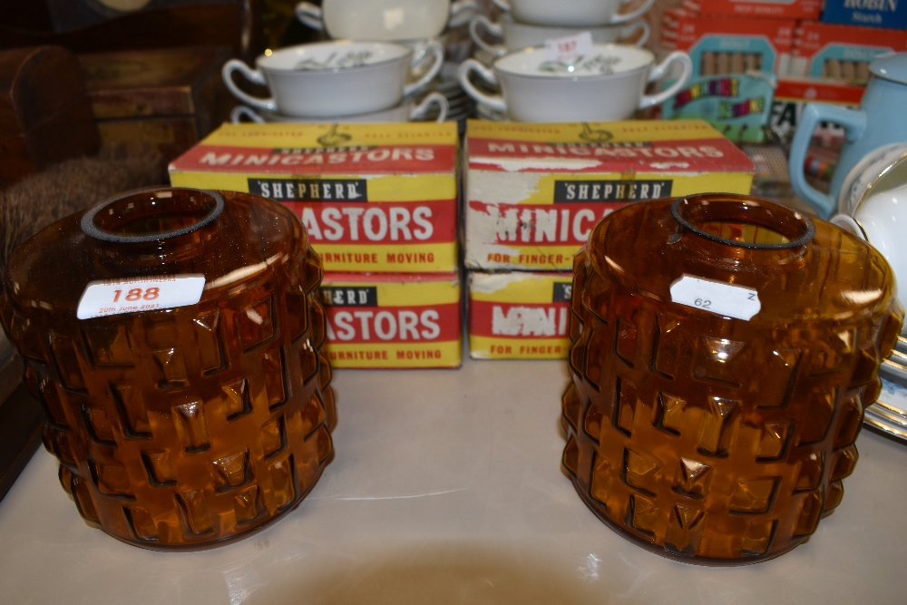 Two mid century amber coloured glass lamp shades and four boxes of Shepherd Minicastors.
