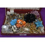 A box containing a selection of costume jewellery brooches including beaded, diamante etc