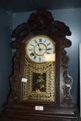 A Victorian wall mounted clock made by the Ansonia clock company in a Gothic design