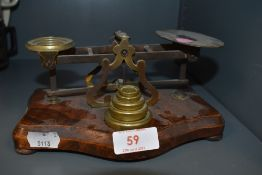 A set of antique chemist or apothecary scales with accompanying weight set