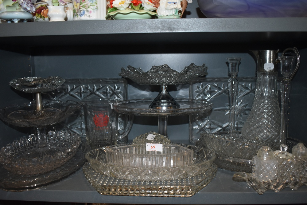 A collection of vintage pressed glass including cruet,dishes,decanter,tazza and more.