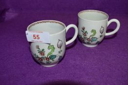 A pair of late 18th century Worcester style chocolate cups having floral pattern and burgundy