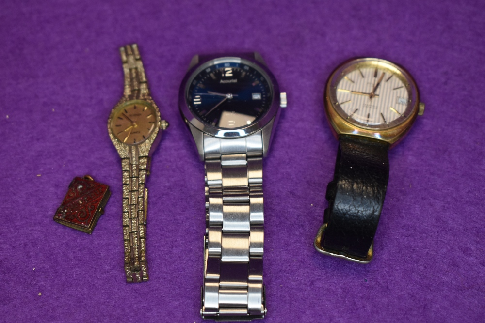Two gents wrist watches, a ladies wrist watch and a royal souvenir charm