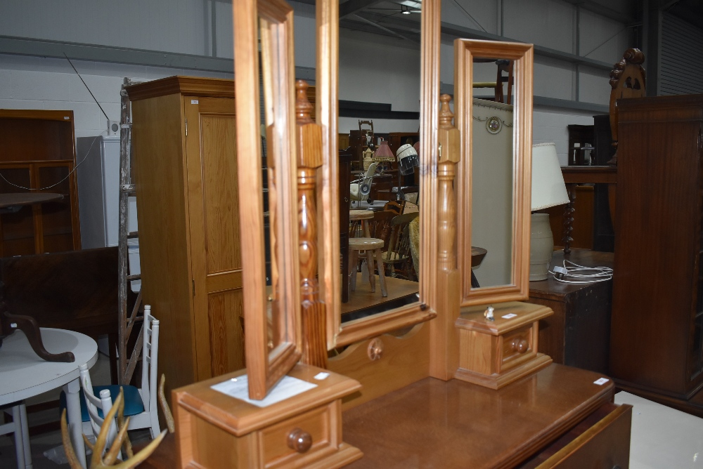 A modern pine dressing table style tri fold mirror with two jewellery drawers