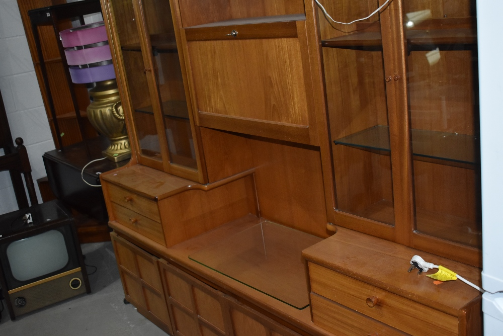 A mid century design wall unit by Nathan having glazed display shelving 190cm long