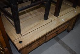 A rustic coffee table with frieze drawer