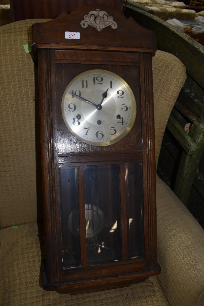 An early 20th Century mahogany cased wall clock