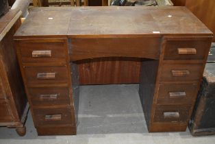 An early 20th Century stained frame dressing table having internal mirror on underside of central