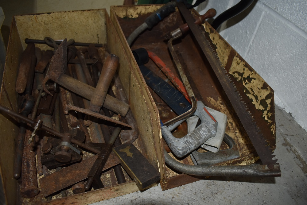 A selection of various hand tools including hide scrapers and set square