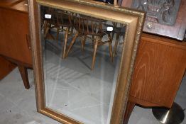 A modern wall mirror, having crackle gilt effect frame
