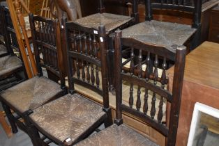 A set of five traditional spindle back rush seated dining chairs