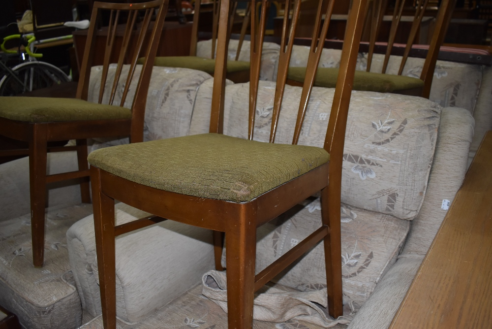 A set of four vintage fork back dining chairs