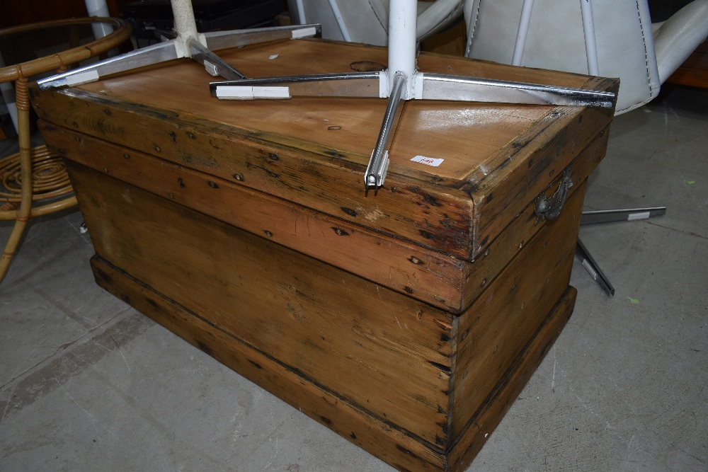 An antique pine chest having dovetail carcass with flat plank top